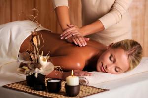 professional masseur doing massage of female back